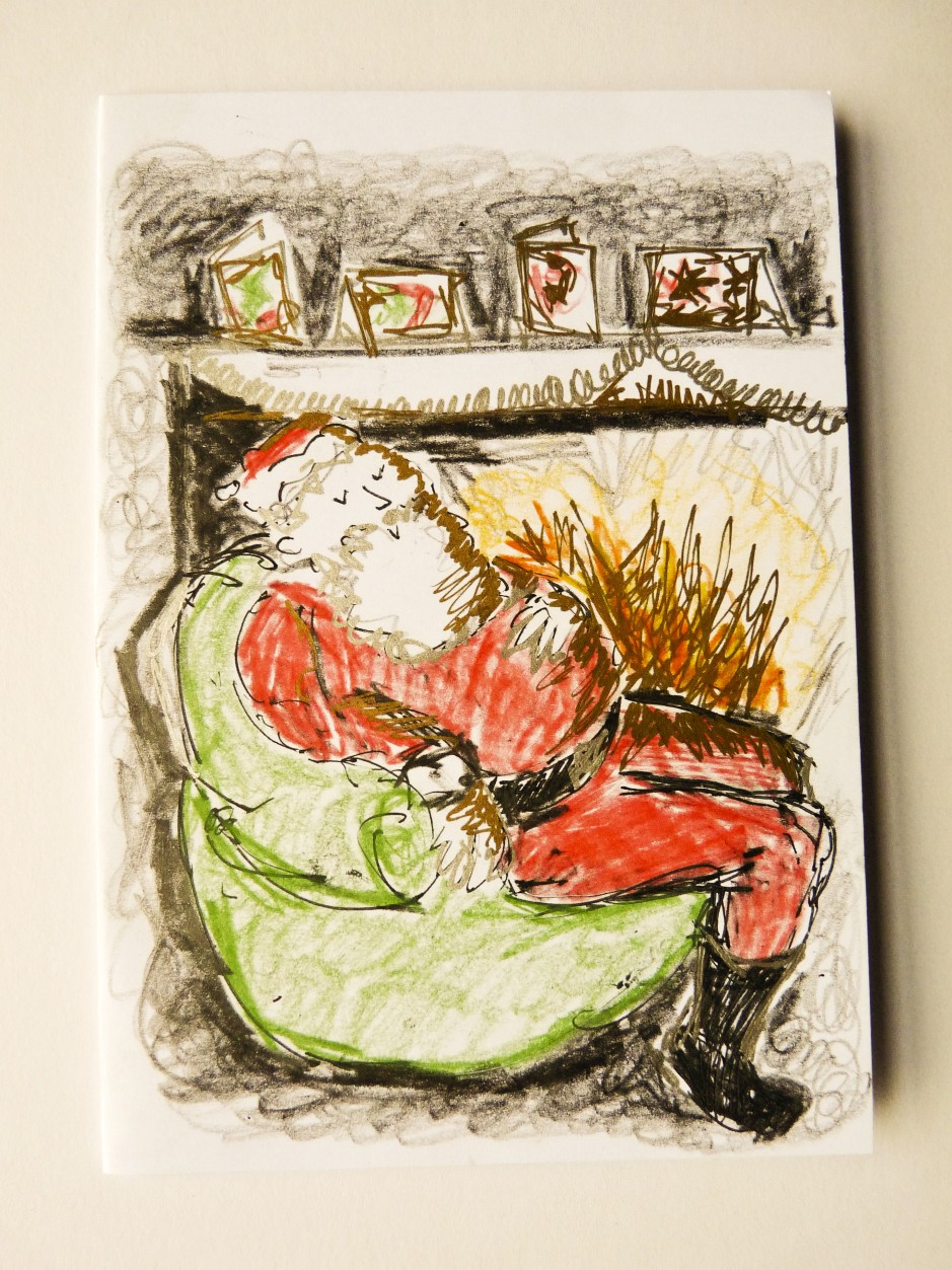 Father Christmas by the fire card